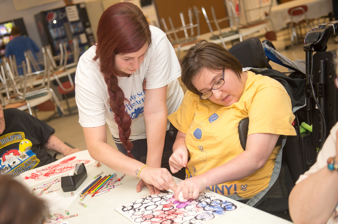 Shayla Fish, a senior art educaton major at Indiana State University, works with developmentally disabled adults at Development Services, Inc. in Terre Haute July 22, 2015 as part of Art for Life, a program offered by the univesity's Community School of the Arts. Photo credit: (ISU/Rachel Keyes)