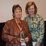 Photo: (Left) Deb Hufty holding the Keystone Award  (Right) Jane Wear, President/CEO at Cardinal Services