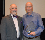 Photo: (Left) Patrick Sandy,  CEO at Easter Seals Crossroads. (Right) James Van Dyke  holding the  James M. Hammond III Award