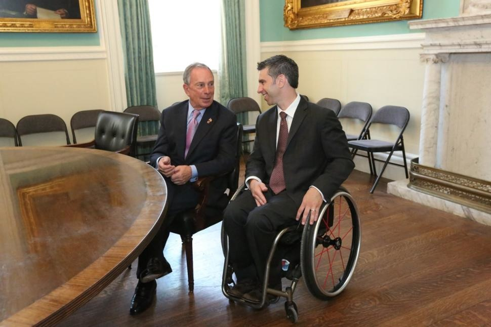 Victor Calise (right, pictured with former Mayor Michael Bloomberg), commissioner of the Mayor's Office for People with Disabilities. Photo credit: Spencer T. Tucker via NYC Mayor Office Flickr